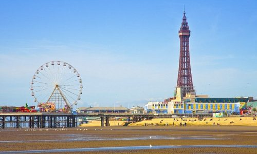 Blackpool, England, UK --- Blackpool Tower and beach at low tide --- Image by © Pawel Libera/Corbis